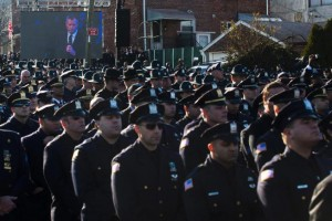 Police officers turn their backs as New York City Mayor Bill de Blasio speaks at the funeral of New York City police officer Rafael Ramos in the Glendale section of Queens on Saturday in New York City. Ramos and his partner, officer Wenjian Liu, were killed Dec. 20 as they sat in their patrol car on a Brooklyn street. The shooter, Ismaaiyl Brinkley, later killed himself.